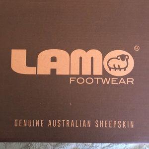 LAMO footwear, closed toe men's slippers.